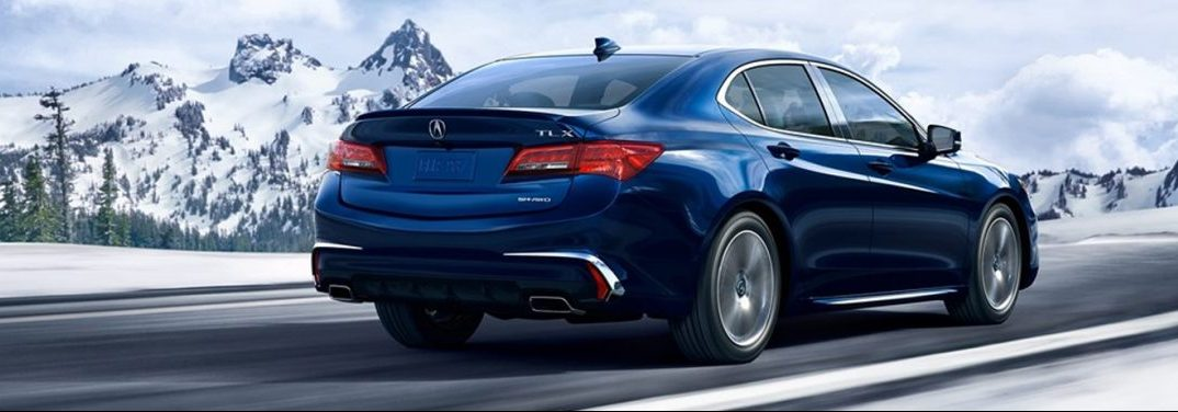 2019 Acura TLX driving by some mountains