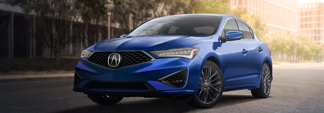 Front driver angle of a blue 2020 Acura ILX parked on a street