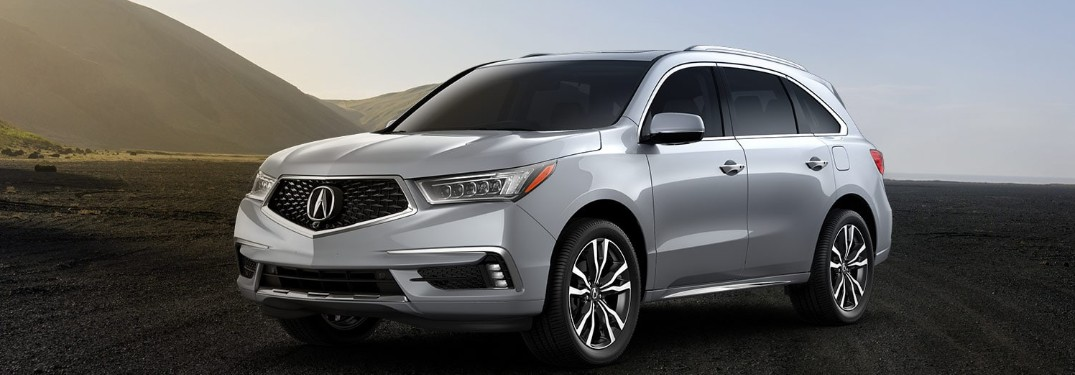 Front driver angle of a silver 2020 Acura MDX parked outdoors