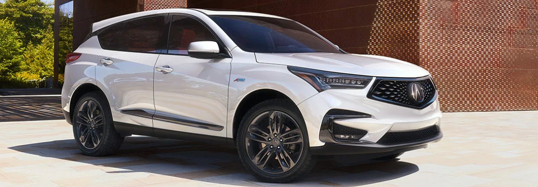 Front passenger angle of a white 2020 Acura RDX