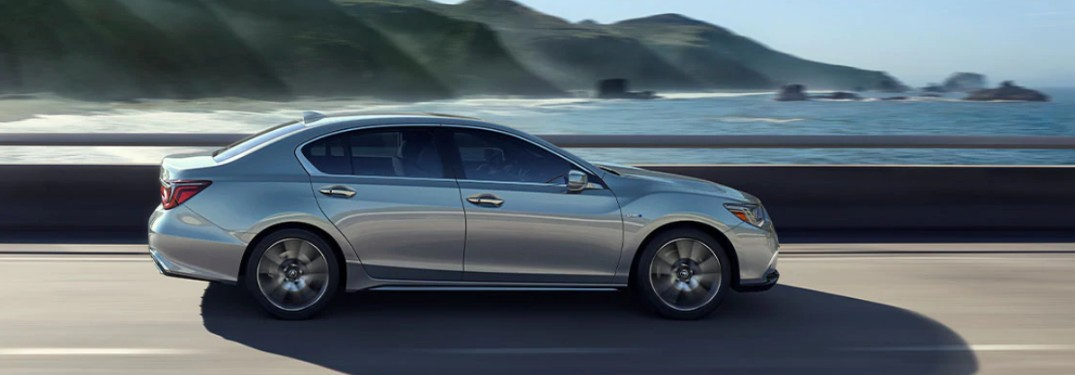 Passenger angle of a silver 2020 Acura RLX driving by the ocean