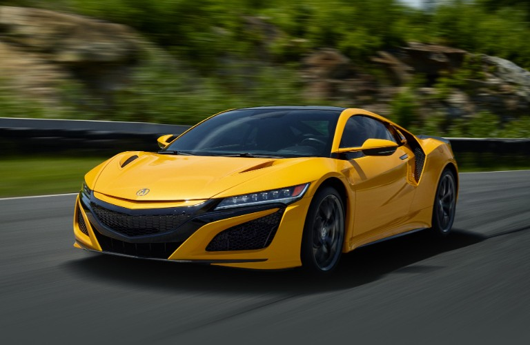 Front driver angle of a yellow 2020 Acura NSX