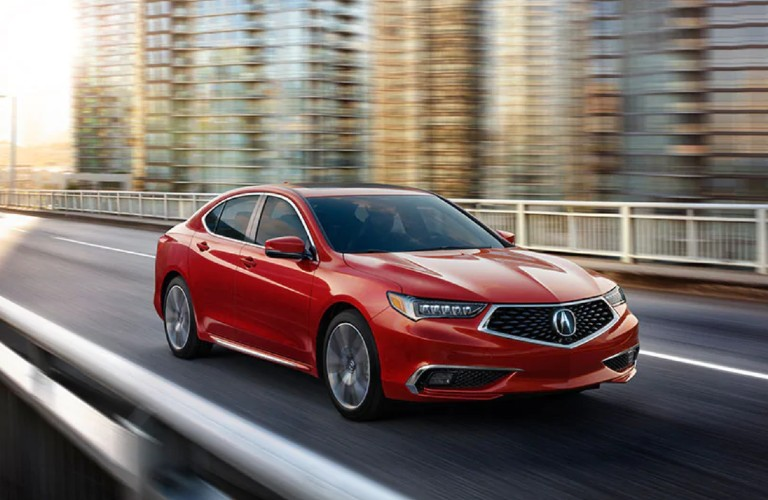Front passenger angle of a red 2020 Acura TLX