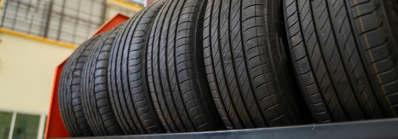 Tires on a rack at a car repair shop