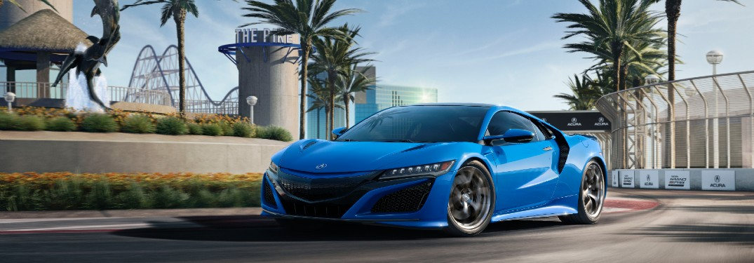 Front driver angle of a blue 2021 Acura NSX