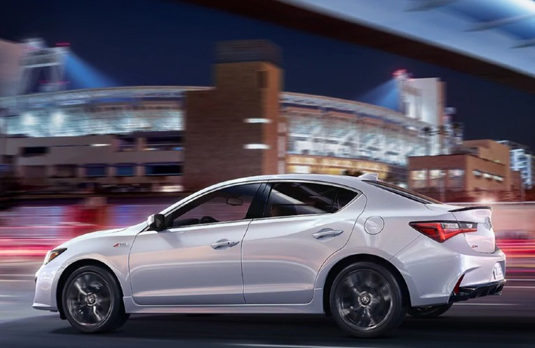 Rear driver angle of a white 2021 Acura ILX
