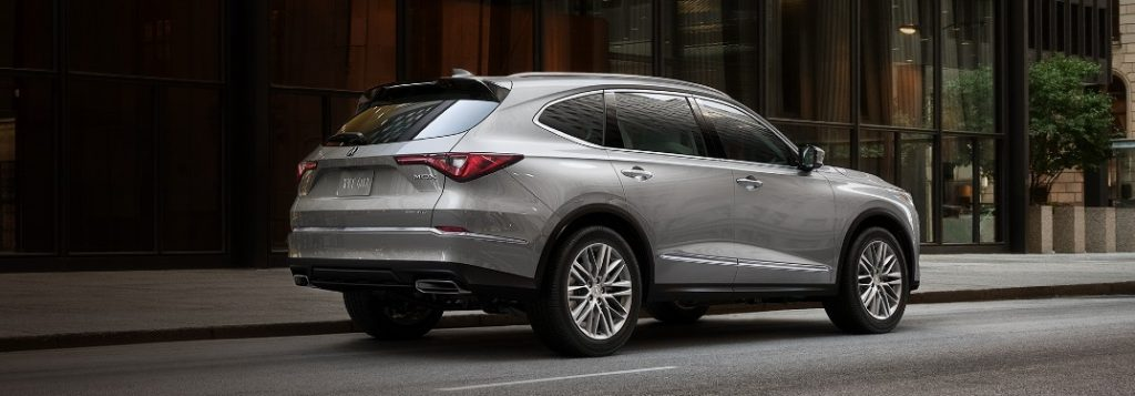 Rear passenger angle of a silver 2022 Acura MDX