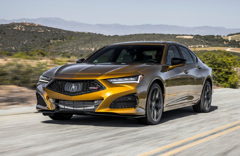 Front driver angle of a yellow 2021 Acura TLX Type S