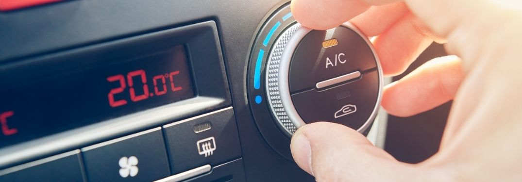 A look at the AC button in a car.