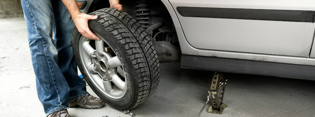 How to change a flat tire in a Ford vehicle