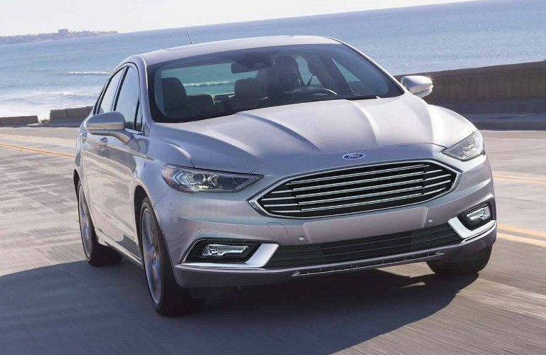 Silver 2018 Ford Fusion driving over bridge