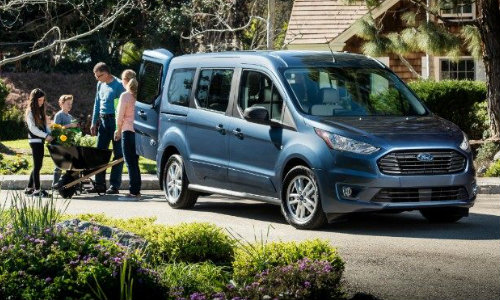 2019 Ford Transit Connect parked in driveway with family surrounding
