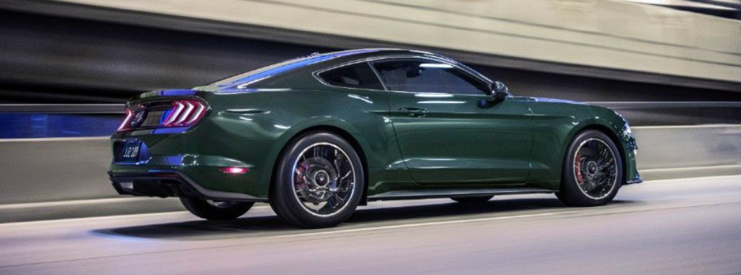 Profile view of 2019 Ford Mustang Bullitt driving on city road