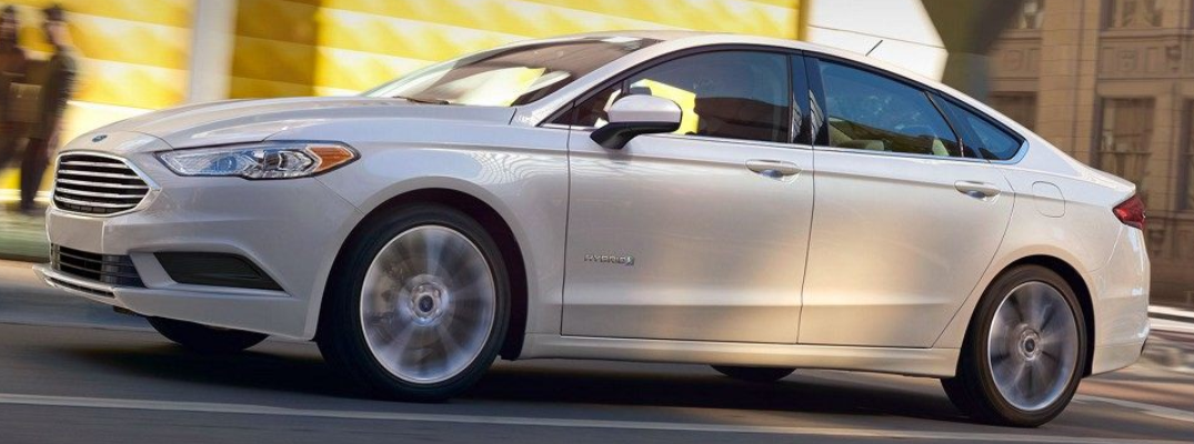 Profile view of white 2018 Ford Fusion in daytime