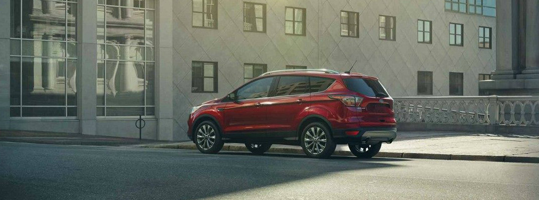 Red 2018 Ford Escape parked in front of modern building