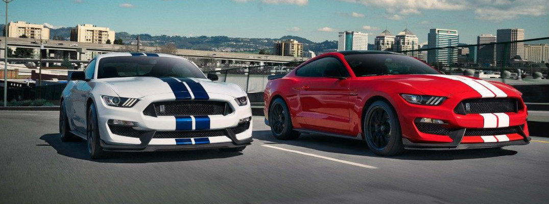 Two 2018 Ford Mustang Shelby GT350 models driving on highway in daytime