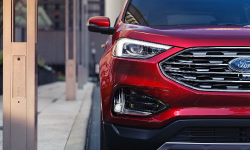 Front grille and headlights of red 2019 Ford Edge