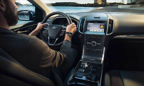 Man inside 2019 Ford Edge with center console in view