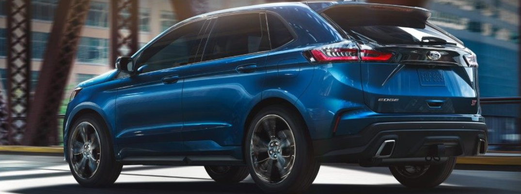 Blue 2019 Ford Edge pictured from rear