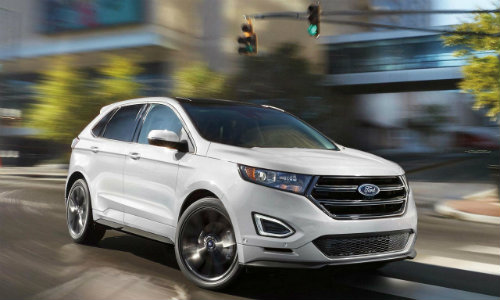 White 2018 Ford Edge driving on tree-lined street