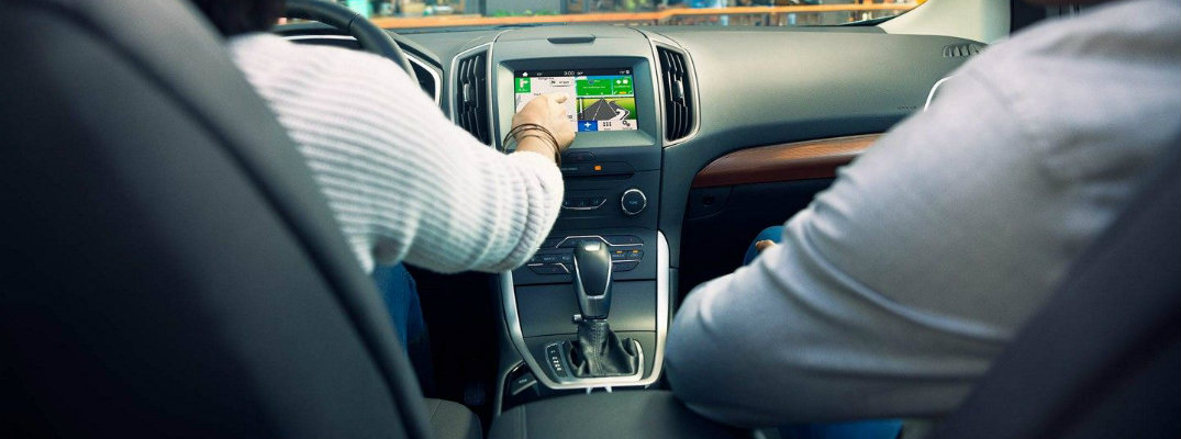 Man operating Ford Bluetooth interface