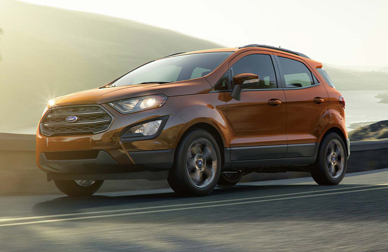 Orange 2018 Ford EcoSport driving on mountainous road