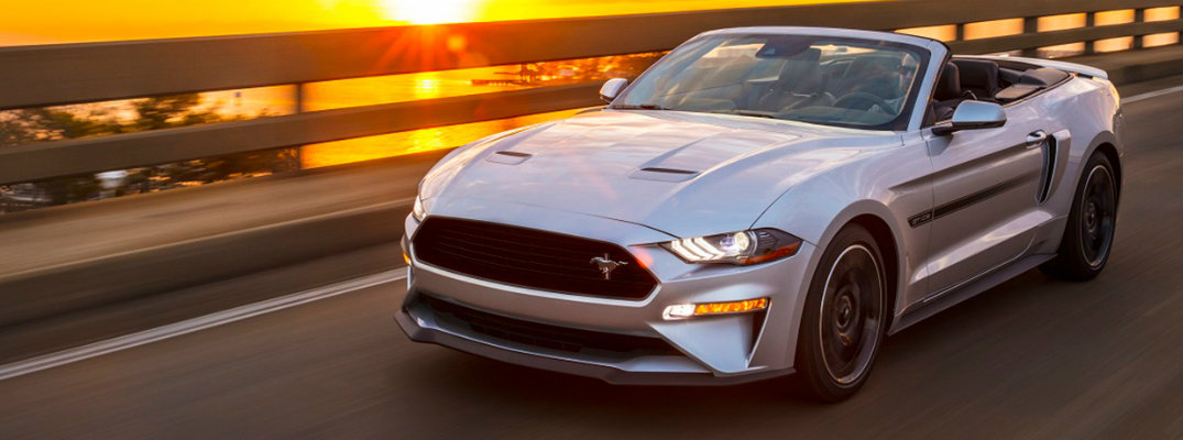 Silver 2019 Mustang driving on bridge
