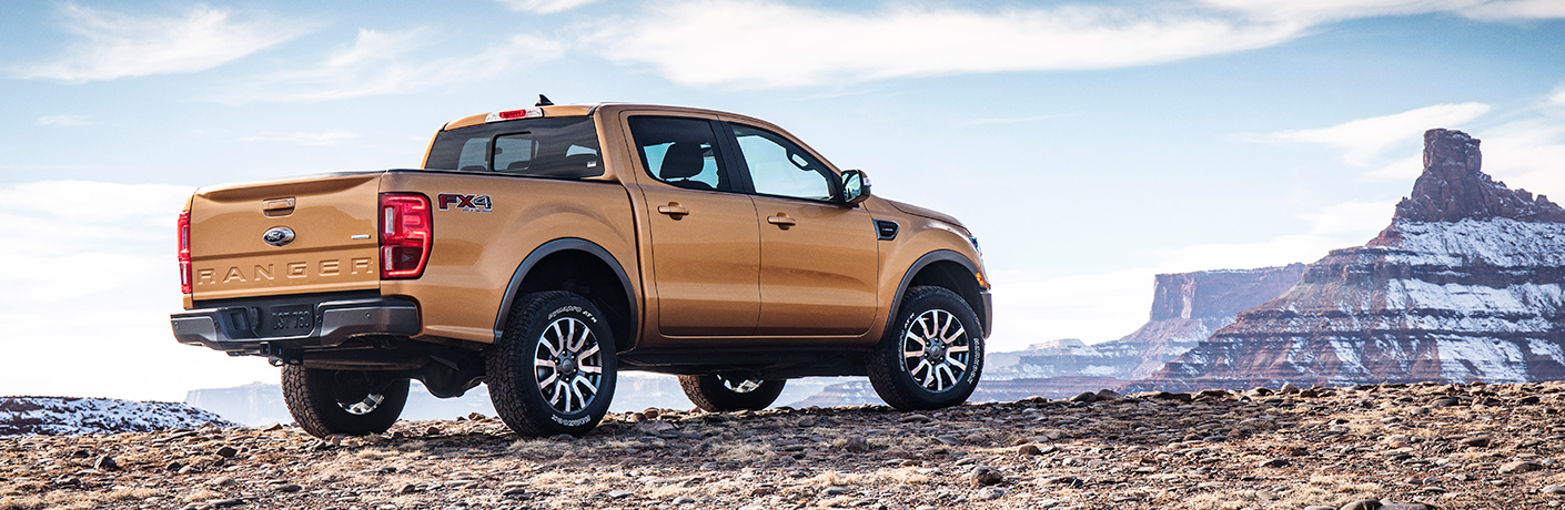 orange 2019 ford ranger on mountain with mountain in distance