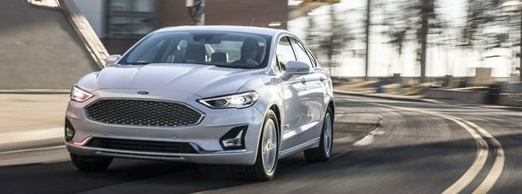 Driver inside white 2019 Ford Fusion