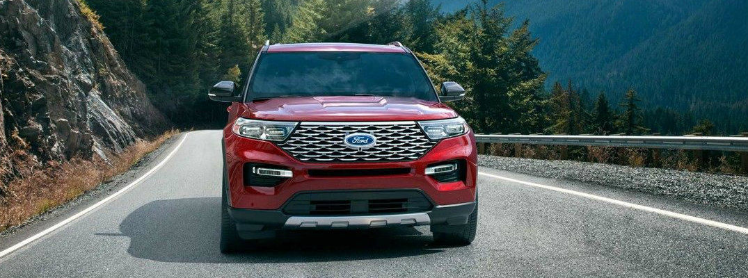 Front view of red 2020 Ford Explorer driving on mountain road