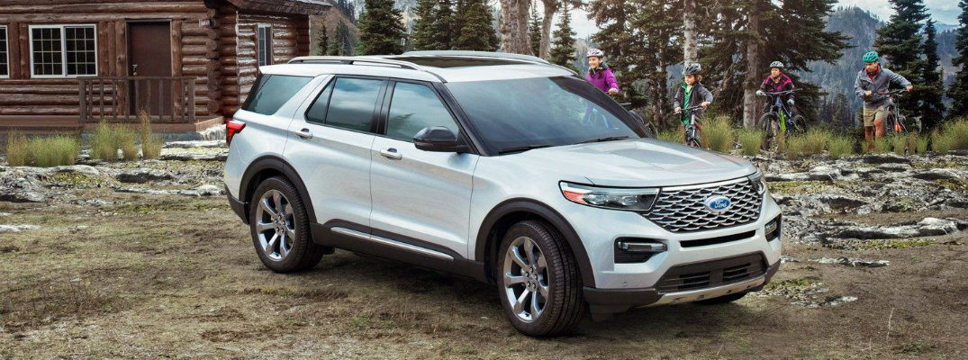 White 2020 Ford Explorer parked in woods with trees surrounding