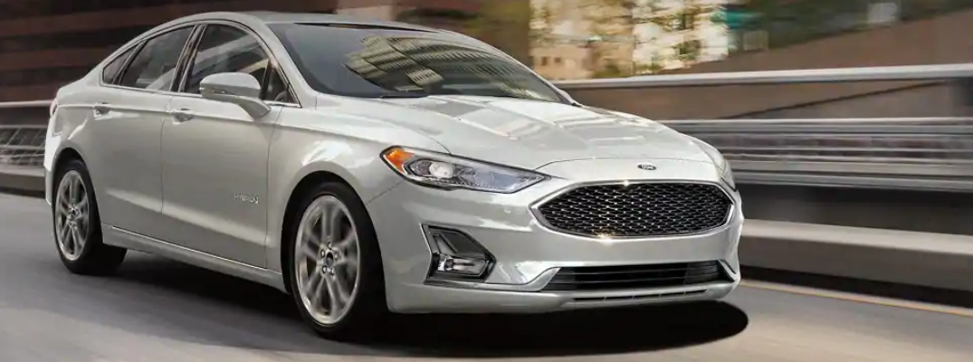 Profile view of white 2019 Ford Fusion