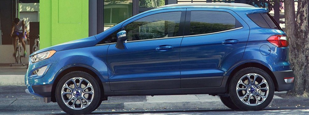 blue 2019 ford ecosport parked outside resturant
