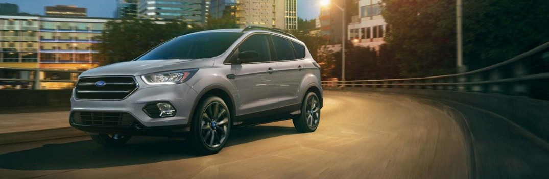 2019 ford escape driving through the city at night