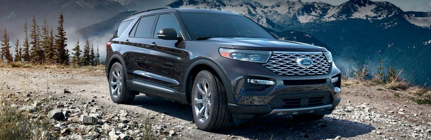 Grey 2020 Ford Explorer driving on a gravel road