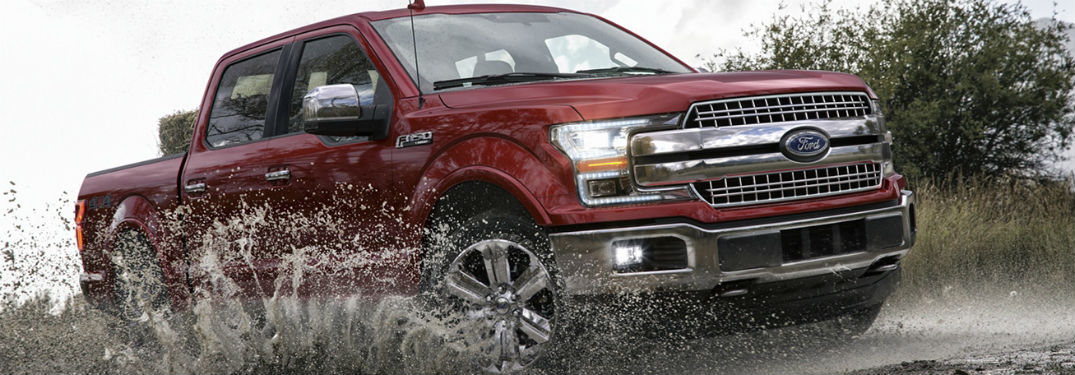 2020 Ford F-150 exterior front fascia passenger side driving through dirty puddle