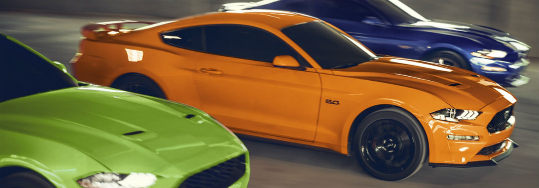2020 Ford Mustang green orange and blue models racing passenger sides showing