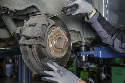 auto mechanic fixing brake disc