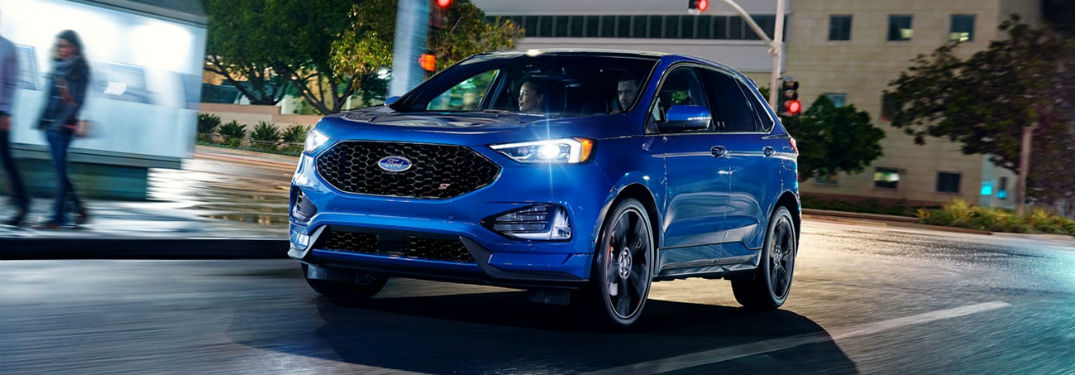 2020 Ford Edge exterior front fascia driver side on road with blurred people walking on sidewalk