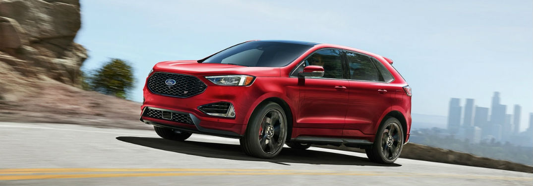 2020 Ford Edge exterior front fascia driver side on highway with city in distance