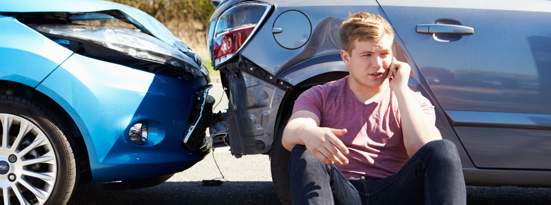A young man calling for help after a car accident