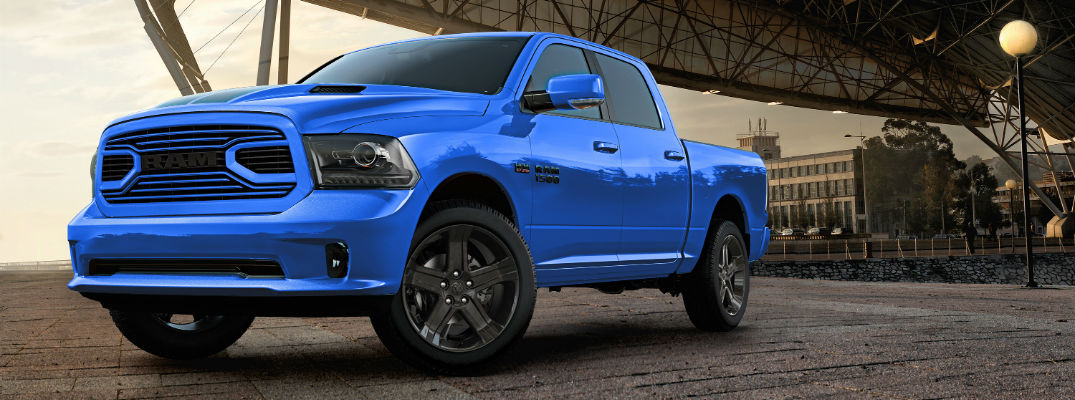 A left front quarter view of the 2018 Ram 1500 Hydro Blue Sport special edition in front of a building