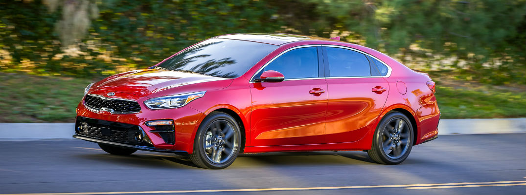 A left profile view of the 2019 Kia Forte cruising along the road