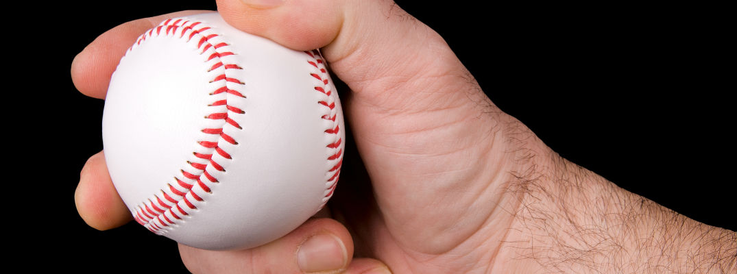 A stock photo of a pitcher's hand holding a baseball.