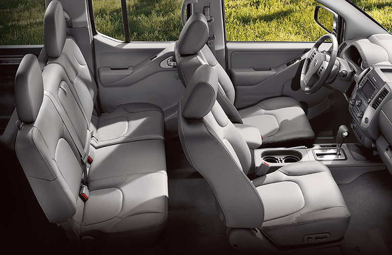 View of 2018 Nissan Frontier gray interior both rows of seating