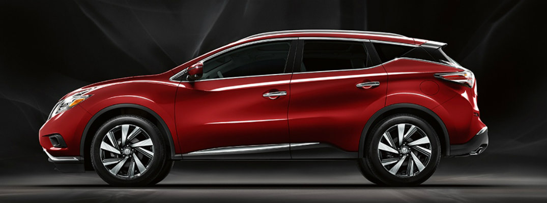 Exterior view of red 2018 Nissan Murano parked against dark background
