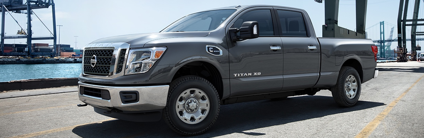 Exterior view of a gray 2018 Nissan TITAN XD parked at the docks
