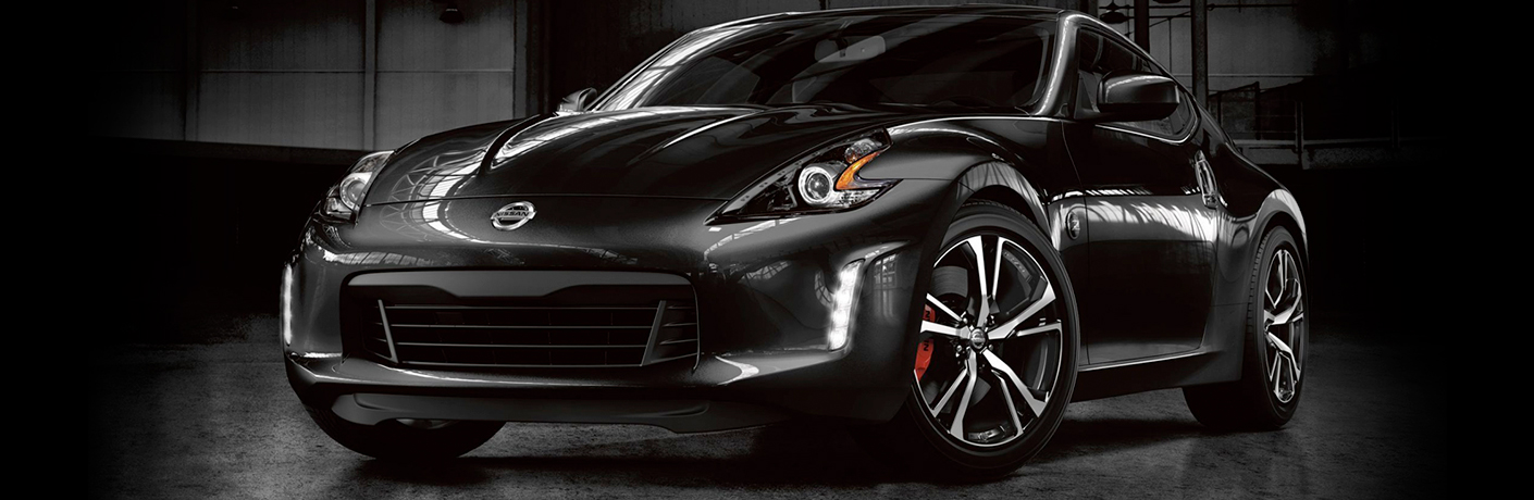 Exterior view of a black 2019 Nissan 370Z inside a dark showroom