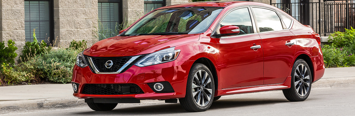 Exterior view of a red 2019 Nissan Sentra praked on a city street