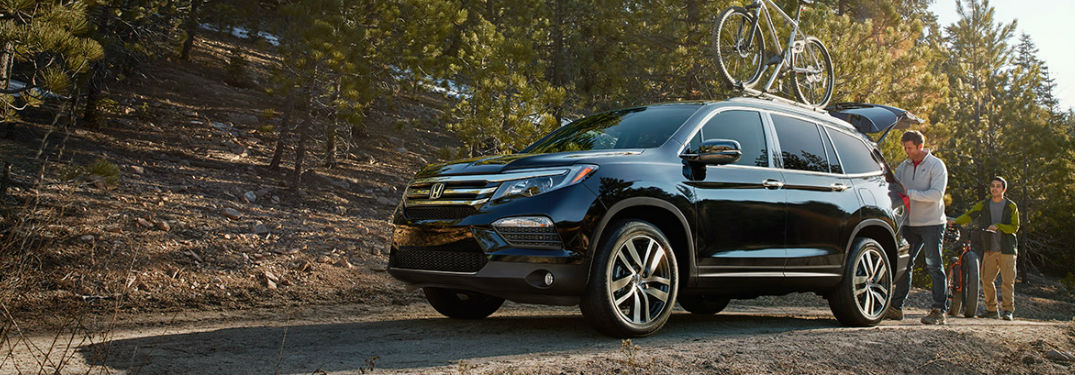 2017 Honda Pilot shown driving on grassy road
